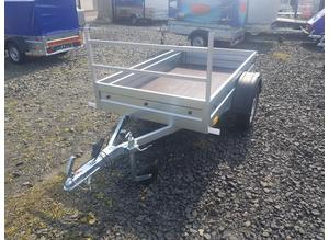 BRAND NEW 6X4 SINGLE AXLE WELDED TRAILER WITH A LADDER RACK.