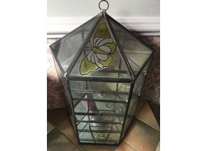 Leaded glass with mirrored back wall display.