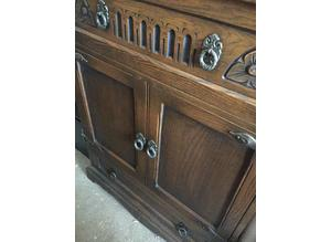 Old Charm oak cupboard with carved features originally TV cabinet