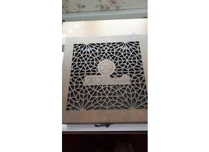Decorative wooden box with fretwork and glass underneath lid