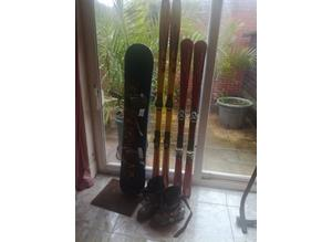 Two sets of skis ,a snowboard,and a large size pair of ski boots for sale