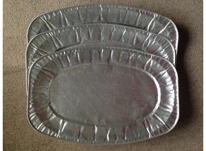 Three large oval foil platters