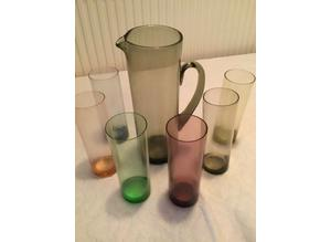 Vintage water/Pims jug and 6 tall coloured glasses